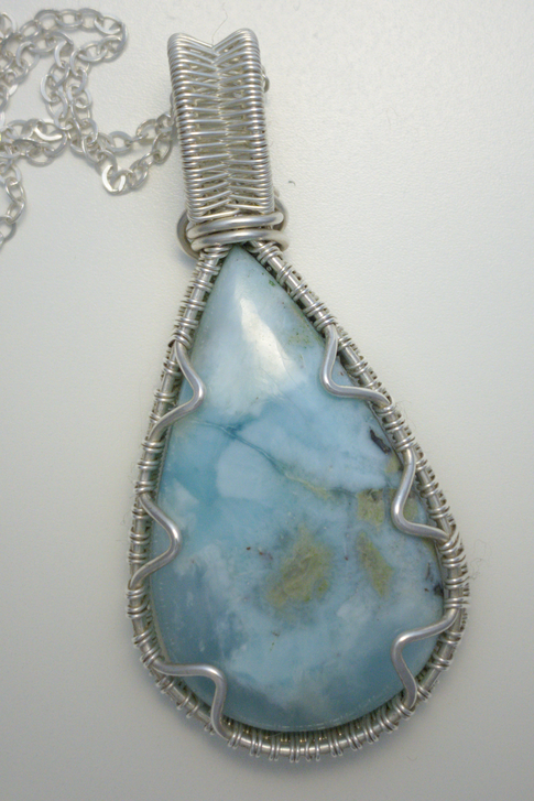Larimar cabochon pendant wrapped with silver wire
